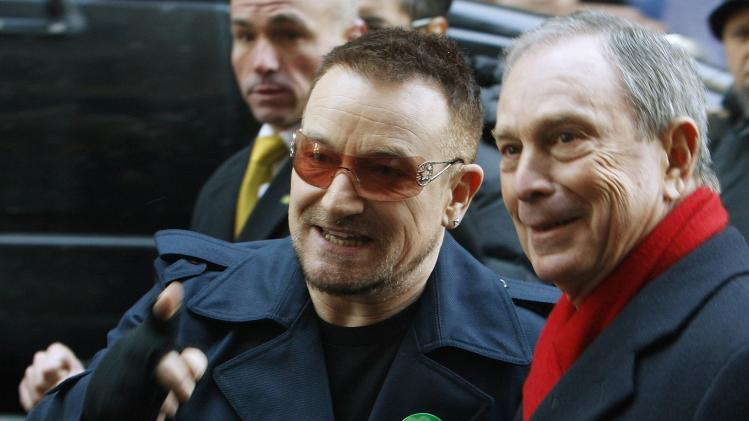 File photo of U2 lead singer Bono walking with New York City Mayor Bloomberg to rename a portion of West 53rd Street as U2 Way in New York