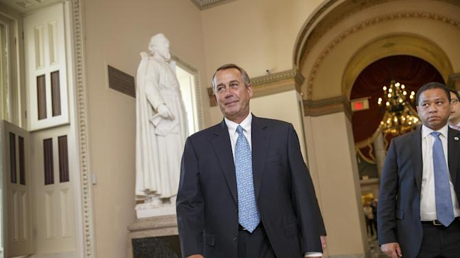 House Speaker John Boehner of Ohio walks to the House chamber on Capitol Hill in Washington, Friday, Feb. 27, 2015, for a procedural vote as Congress moves toward a spending bill for the Homeland Security Department hours before a shutdown was to begin.  (AP Photo/J. Scott Applewhite)