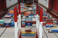 Containers are loaded at Qingdao port in east China's Shandong province. Manufacturing in Asia further weakened last month, with activity in China hitting a more than three year low, as leaders faced calls for action to avoid a sharper slowdown