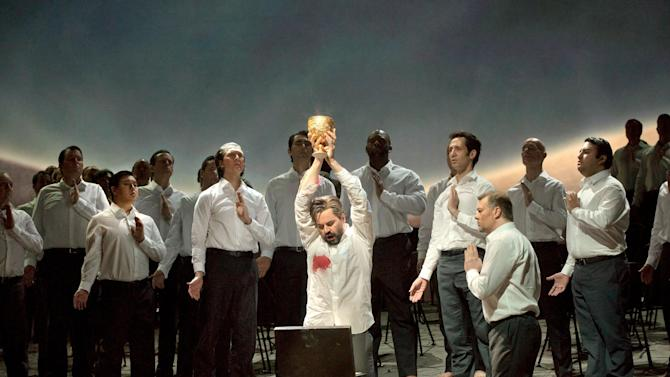 "In this Feb. 11, 2013 photo provided by the Metropolitan Opera, Peter Mattei performs as Amfortas in Wagner's ""Parsifal,"" during the final dress rehearsal at the Metropolitan Opera in New York. Amfortas, though a supporting role, is crucial to ""Parsifal."" He's the leader of the Knights of the Grail, but is unable to perform his duties because of an agonizing wound inflicted on him by a sorcerer after he was seduced by a beautiful woman. (AP Photo/ Metropolitan Opera, Ken Howard)"