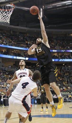Gonzaga races by listless West Virginia 77-54