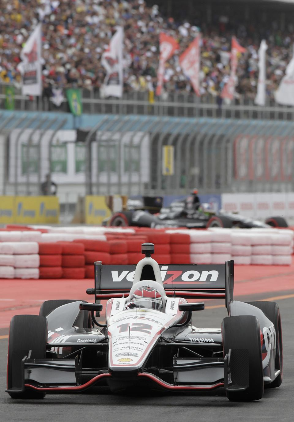 IndyCar driver Will Power, of Australia steers his car on the IndyCar's Sao Paulo 300 track, in Sao Paulo, Brazil, Sunday, April 29, 2012.  (AP Photo/Andre Penner)
