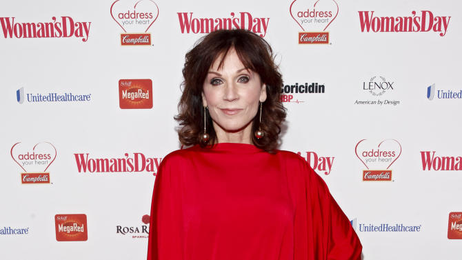 IMAGE DISTRIBUTED FOR CAMPBELL'S - Actress Marilu Henner walks the red carpet at the Woman's Day Red Dress Awards on Tuesday, Feb. 12, 2013, in New York City. (Brian Ach/AP Images for Campbell's)