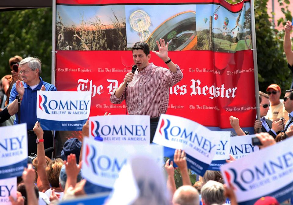 Republican Vice Presidential candidate, Rep. Paul Ryan, R-Wis., accompanied by Iowa Gov. Terry Branstad, left, speaks at the Iowa State Fair in Des Moines, Monday, Aug. 13, 2012.  (AP Photo/Conrad Schmidt)