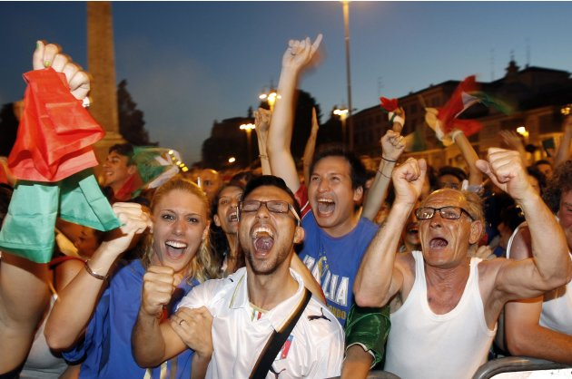 Italian supporters celebrate after their team beat Germany during their Euro 2012 semi-final soccer match, in Rome