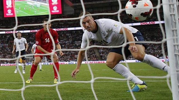 England's Rickie Lambert (R) heads the ball to score during their 2014 World Cup qualifying match against Moldova (Reuters)