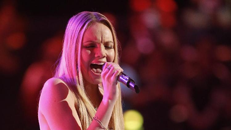 "This June 17, 2013 photo released by NBC shows finalist Danielle Bradbery performing on the singing competition series ""The Voice,"" in Los Angeles. Bradbery will compete against Michelle Chamuel and brother duo Zach and Colton Swon during the finale on Tuesday, June 18. (AP Photo/NBC,Trae Patton)"