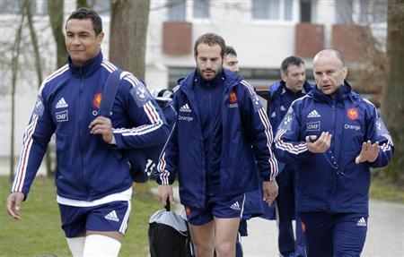 France's rugby team players Dusautoir and Michalak and coach assistant Bru arrive to attend a training session at the Rugby Union National Centre in Marcoussis