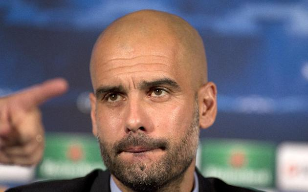 Bayern Munich's head coach Pep Guardiola listens to a question during a press conference in London, Tuesday, Feb. 18, 2014, ahead of their round of 16 Champions League soccer match against Arsenal