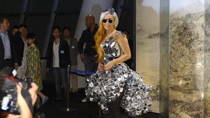 "Lady Gaga poses as she visits the Tokyo Sky Tree, the world's tallest freestanding broadcast structure that stands 634-meter (2,080 feet), in Tokyo Tuesday, May 15, 2012. Lady Gaga might have to cancel her sold-out show in Indonesia because Islamic hard-liners and conservative lawmakers objected. National police spokesman Boy Rafli Amar said the permit was denied for the June 3, 2012,  ""Born This Way"" concert that was to be the biggest show on her Asian tour. (AP Photo/Kyodo News) JAPAN OUT, MANDATORY CREDIT, NO LICENSING IN CHINA, HONG KONG, JAPAN, SOUTH KOREA AND FRANCE"