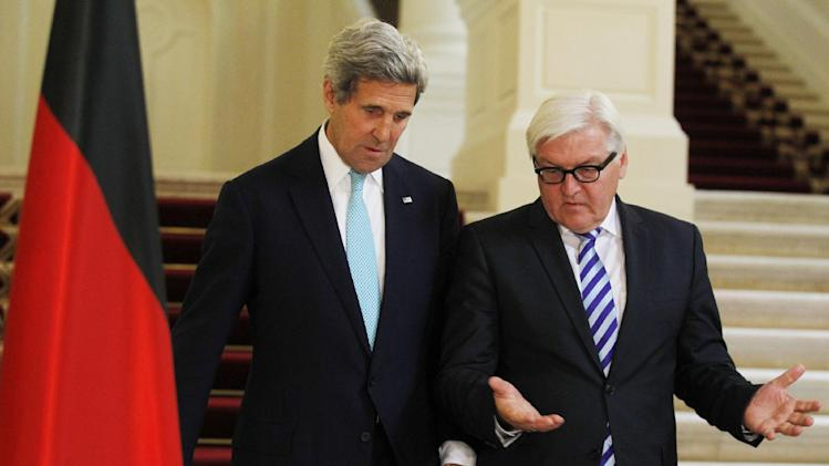 U.S. Secretary of State John Kerry, left and German Foreign Minister Frank-Walter Steinmeier talk as they walk though the Coburg Hotel to a press conference, after talks between the foreign ministers of the six powers negotiating with Tehran on its nuclear program, in Vienna, Austria, Sunday, July 13, 2014. Discussions center on imposing long-term restrictions on Iran's uranium enrichment and against plutonium production — materials usable in nuclear warheads. In exchange, the U.S. and other powers would scrap a series of trade and oil sanctions against Tehran. (AP Photo/Jim Bourg, Pool)