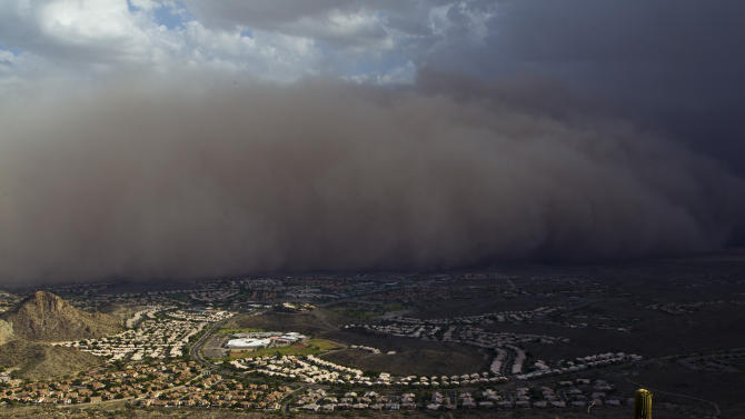 A dust storm rolls through the Ahwatukee and south Phoenix area, Monday evening,  July 18, 2011. The dust wall was about 3,000 feet (900 meters) high and created winds of 25 to 30 mph (40 to 48 kph), with gusts of up to 40 mph (64 kph), said Austin Jamison, a meteorologist with the National Weather Service. (AP Photo/The Arizona Republic, Nick Oza)  MARICOPA COUNTY OUT; MAGS OUT; NO SALES