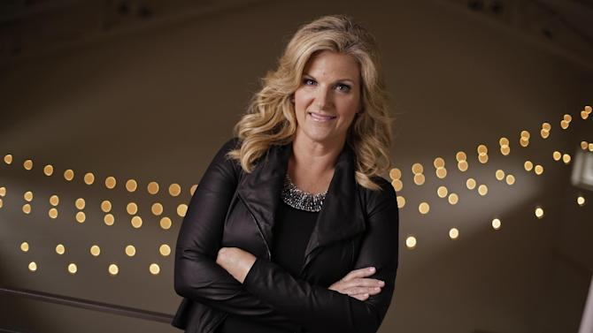 """This Aug. 18, 2014 photo shows country singer Trisha Yearwood in Nashville, Tenn. Yearwood announced Tuesday, Aug. 19 she's releasing new music _ a hits package with six new songs called """"Prizefighter"""" _ to coincide with the looming comeback tour with her husband, Garth Brooks. She's also launching cookware and cutlery lines, begins a new season of """"Trisha's Southern Kitchen"""" next week and has her third cookbook out next spring. (AP Photo/Mark Humphrey)"""