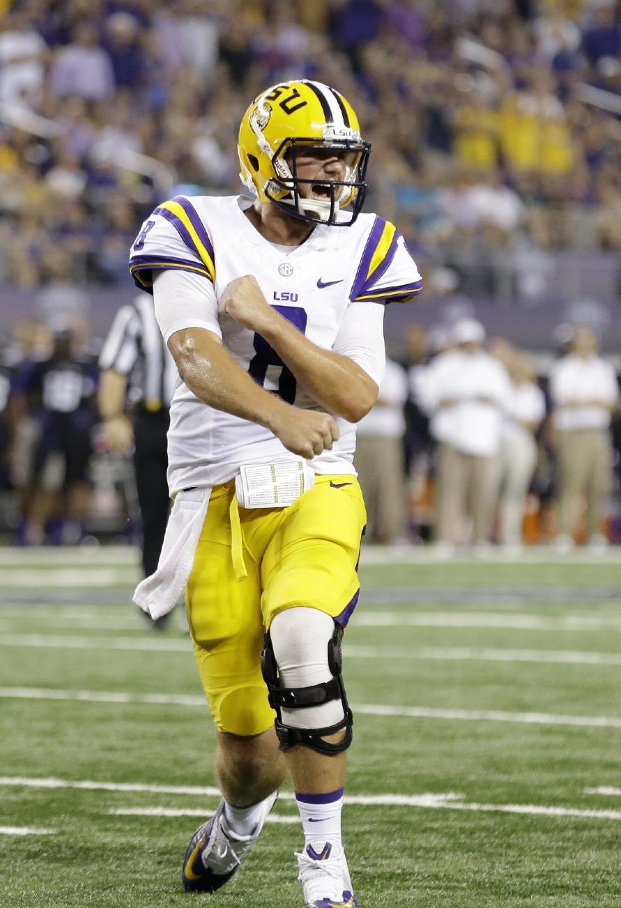 LSU quarterback Zach Mettenberger (8) celebrates a touchdown by teammate J.C. Copeland during the first half of an NCAA college football game against TCU, Saturday, Aug. 31, 2013, in Arlington, Texas. (AP Photo/LM Otero)