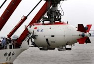 "The Chinese submersible ""Jiaolong"" is lifted into the Huanghai sea in Jiangyin in 2011. The Jiaolong craft has arrived at a designated area in the Pacific Ocean aboard a Chinese ship and is set to dive 7,000 metres (22,960 feet) into the Mariana Trench, the official Xinhua news agency said Monday"