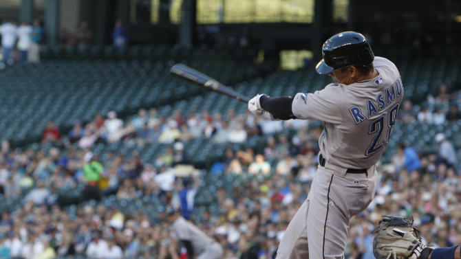 Toronto Blue Jays' Colby Rasmus hits a three-run double in the first inning against the Seattle Mariners during a baseball game in Seattle, on Tuesday, August 16, 2011. (AP Photo/Kevin P. Casey)