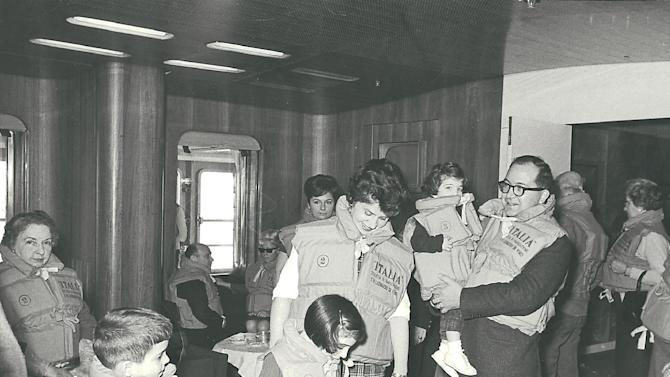 This 1965 photo provided by Anne D'Innocenzio shows her in the arms of her father, with her mother, sister and brother on a ship heading home from a family sojourn in Italy. As an adult, D'Innocenzio continues to enjoy vacationing with her mother, even though their travel styles sometimes differ and their roles have reversed a bit, with D'Innocenzio doing more of the caretaking for her aging parent. (AP Photo)