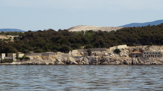 In this photo taken June 28, 2012, the Adriatic island of Goli Otok is seen from the sea. The prison island housed up to 16,000 political prisoners over an eight-year period. They ended up there after being accused by Tito's regime of expressing sympathy toward Josef Stalin and his hardline Soviet dictatorship. (AP Photo/Darko Bandic)