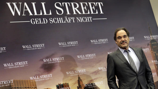 Director Oliver Stone poses for the photographers during a photo-call for the new movie 'Wall Street, Money Never Sleeps' in Berlin, Germany, Tuesday, Oct. 12, 2010. (AP Photo/Michael Sohn)