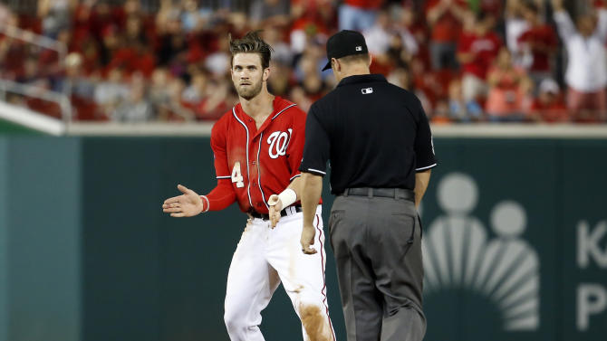 Washington Nationals' Bryce Harper (34) celebrates his double as he stands on second base during the eighth inning of a baseball game against the San Francisco Giants at Nationals Park, Sunday, July 5, 2015, in Washington. The Nationals won 3-1. (AP Photo/Alex Brandon)
