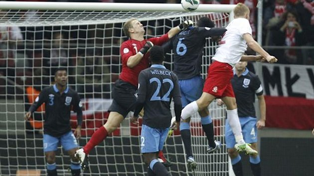 Joe Hart fails to reach the ball as Poland equalise