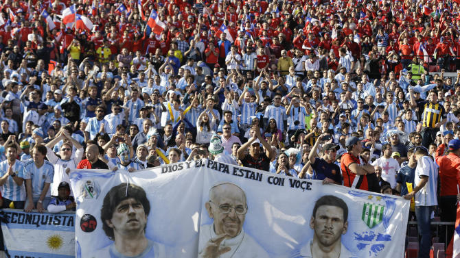 Argentina's fans hold a banner with the images of Argentina's Lionel Messi, right, Pope Francis, center, and Argentina soccer legend Diego Maradona, left, during the Copa America final soccer match between Argentina and Chile at the National Stadium in Santiago, Chile, Saturday, July 4, 2015. (AP Photo/Ricardo Mazalan)
