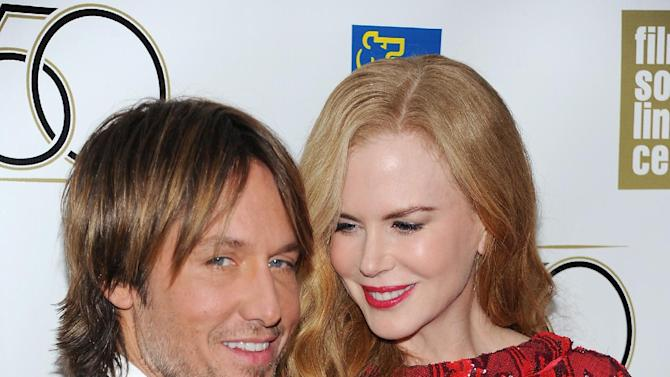 """Actress Nicole Kidman and her husband Keith Urban attend the premiere of """"The Paperboy"""" during the 2012 New York Film Festival at Alice Tully Hall on Wednesday Oct. 3, 2012 in New York. (Photo by Evan Agostini/Invision/AP)"""