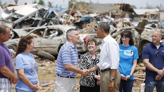 "President Barack Obama greets Robert Romines, Asst. Superintendent, Personnel for Moore Schools, and Susan Pierce, Superitendent of Moore Schools, and tornado victims at Plaza Towers Elementary in Moore, Okla., on Sunday, May 26, 2013. Obama visited tornado-devastated Moore, Oklahoma, consoling people staggered by the loss of life and property and promising that the government will be behind them ""every step of the way."" (AP Photo/The Oklahoman, Bryan Terry, Pool)"