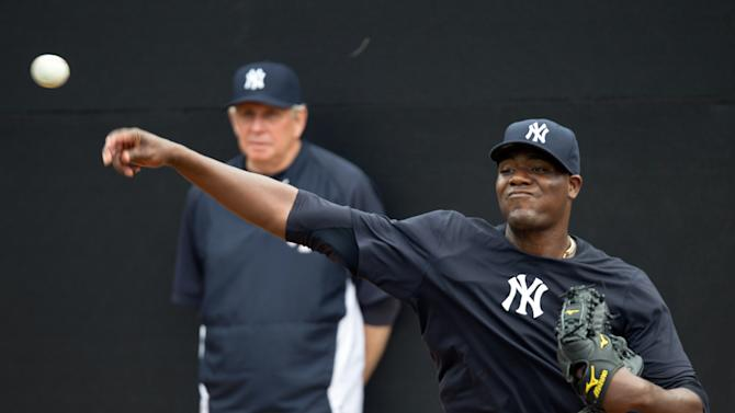 New York Yankees pitcher Michael Pineda throws the ball as pitching coach Larry Rothschild watches during baseball spring training at George M. Steinbrenner Field Tuesday, Feb. 12, 2013, in Tampa, Fla. (AP Photo/Scott Iskowitz)