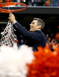 GREENSBORO, NC - MARCH 16: Head coach Tony Bennett of the Virginia Cavaliers cuts down the net after defeating the Duke Blue Devils to win the championship game of the 2014 Men's ACC Basketball Tournament at Greensboro Coliseum on March 16, 2014 in Greensboro, North Carolina. (Photo by Streeter Lecka/Getty Images)