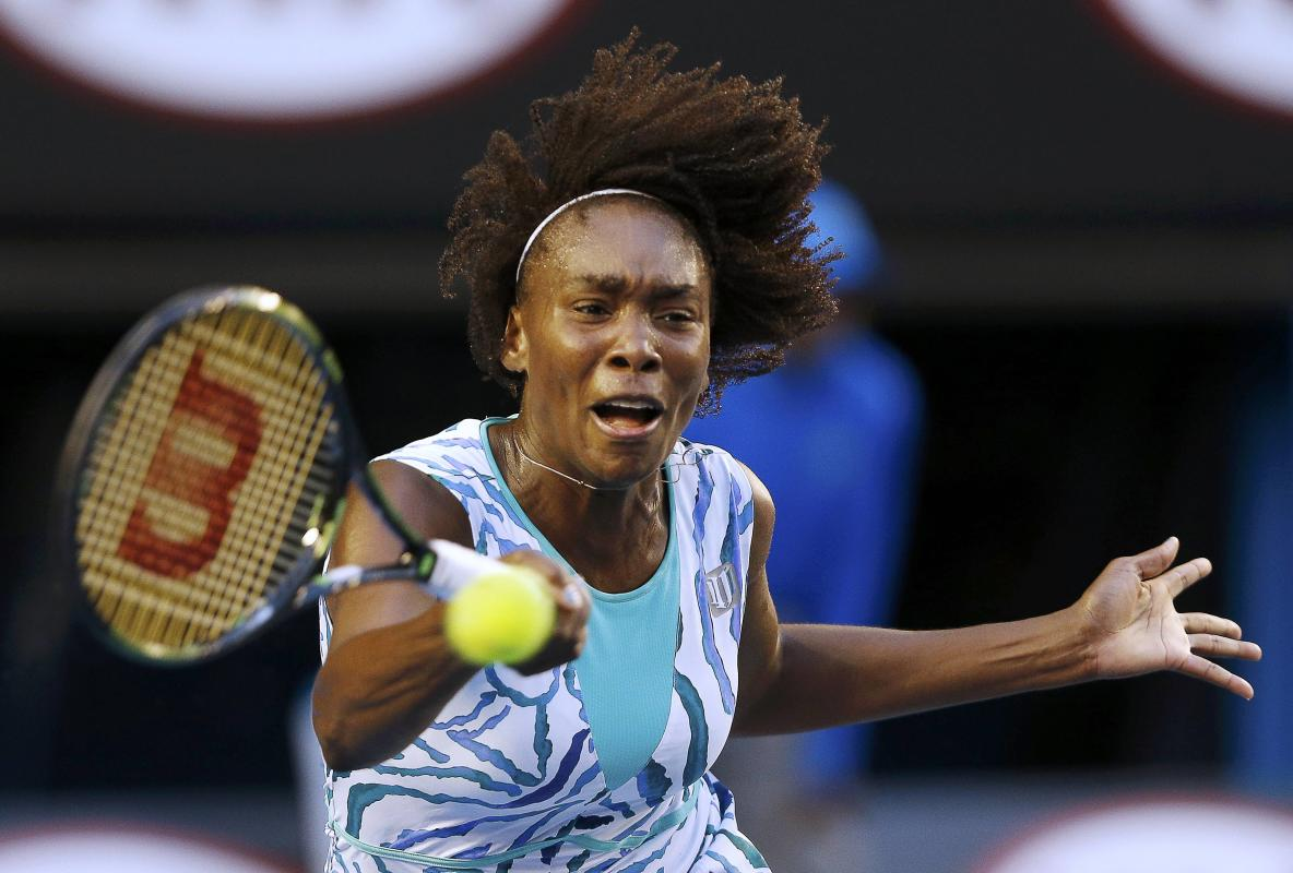 Venus of the U.S. hits a return to Radwanska of Poland during their women's singles match at the Australian Open 2015 tennis tournament in Melbourne