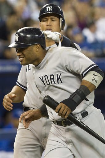 Yankees beat Blue Jays 9-6, clinch playoff berth