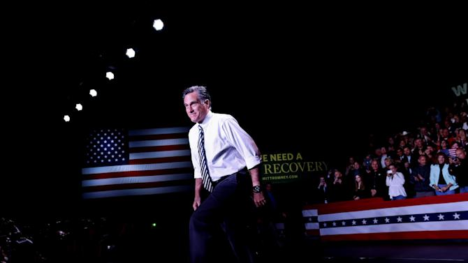 Republican presidential candidate, former Massachusetts Gov. Mitt Romney arrives at an election campaign rally at the Reno Event Center in Reno, Nev., Wednesday, Oct. 24, 2012. (AP Photo/Charles Dharapak)