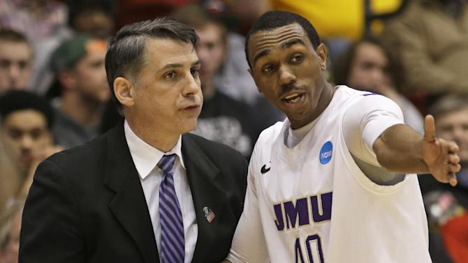 James Madison head coach Matt Brady, left, talks with guard Devon Moore (40) in the second half of a first-round game against LIU Brooklyn in the NCAA college basketball tournament on Wednesday, March 20, 2013, in Dayton, Ohio. (AP Photo/Al Behrman)