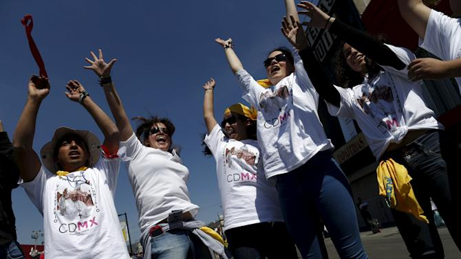 Youth dance outside Guadalupe's basilica while waiting for the arrival of Pope Francis in Mexico City