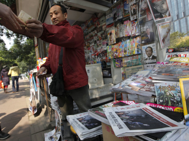 <p>               In this Thursday, Jan. 10, 2013 photo, a man buys a latest edition of the Southern Weekly at a newspaper stand near the Southern Weekly headquarters in Guangzhou, Guangdong province, China. China's new Communist Party leaders want to appear more open, but they're not about to give up control of the media. That's the lesson of a dustup involving the influential newspaper whose staff briefly rebelled against especially heavy-handed censorship. The staff of Southern Weekly returned to work after some controls were relaxed, but public demands for the ouster of the top censor were ignored. (AP Photo/Vincent Yu)