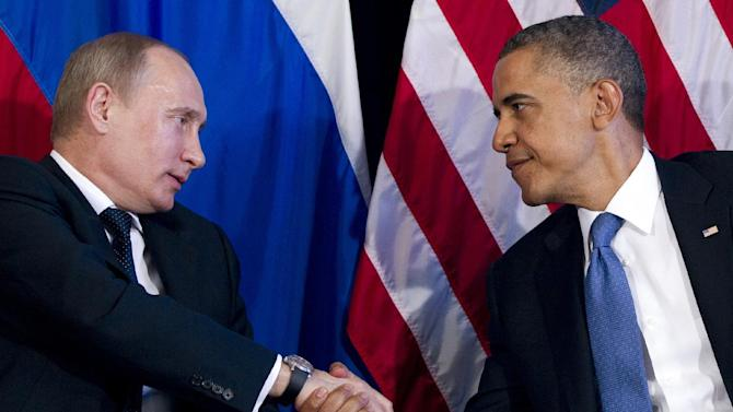 President Barack Obama shakes hands with Russia's President Vladimir Putin in a bilateral meeting during the G20 Summit, Monday, June 18, 2012, in Los Cabos, Mexico. (AP Photo/Carolyn Kaster)