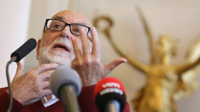 Nobel Prize winner for Physics, Belgium's Francois Englert speaks during a news conference at the University of Brussels in Brussels on Tuesday, Oct. 8, 2013. Englert and Peter Higgs of Britain won the 2013 Nobel Prize in physics on Tuesday for their theory on how the most basic building blocks of the universe acquire mass, eventually forming the world we know today. (AP Photo/Virginia Mayo)