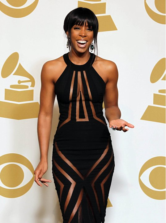 Kelly Rowland poses backstage …