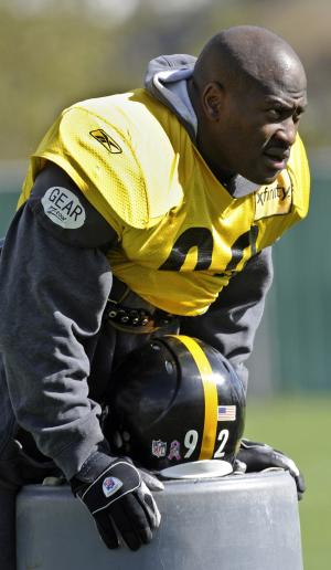 Pittsburgh Steelers linebacker James Harrison looks on during a team workout in Pittsburgh, Pa., Thursday, Oct. 21, 2010. Harrison returned to the Steelers one day after he threatened to retire because of the NFL's stricter enforcement of dangerous hits.  (AP Photo/Pittsburgh Post-Gazette, Bob Donaldson) ** PITTSBURGH OUT, GREENSBURG OUT, TARENTUM OUT, MONESSEN OUT. NO ARCHIVES, NO SALES, NO TV, NO INTERNET, NO MAGS **