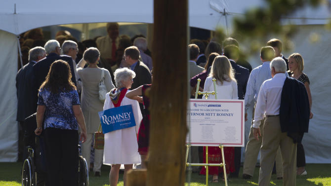People line up for a fundraiser for Republican presidential candidate, former Massachusetts Gov. Mitt Romney hosted by former Vice President Dick Cheney on Thursday, July 12, 2012 in Wilson, Wyo.  (AP Photo/Evan Vucci)