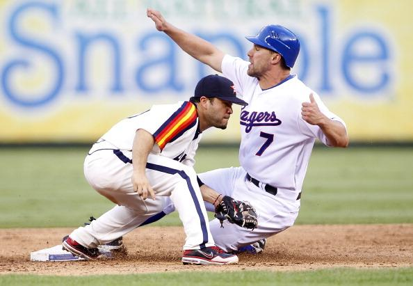 David Murphy #7 of the Texas Rangers steals second base beating the tag by Jose Altuve #27 of the Houston Astros at Rangers Ballpark in Arlington on June 16, 2012 in Arlington, Texas. (Photo by Rick Yeatts/Getty Images)