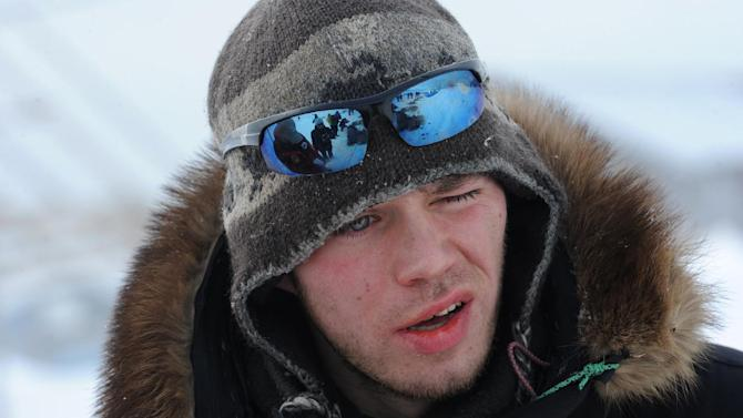 Norwegian musher Joar Leifseth Ulsom looks into the wind at his team after arriving in Unalakleet on Sunday, March 10, 2013, during the Iditarod Trail Sled Dog Race. (AP Photo/Anchorage Daily News, Bill Roth)