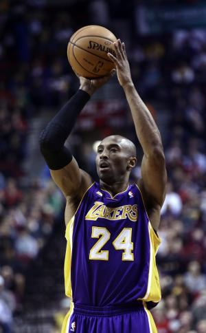 Los Angeles Laker guard Kobe Bryant shoots during the first quarter of an NBA basketball game against the Portland Trail Blazers in Portland, Ore., Wednesday, April 10, 2013.(AP Photo/Don Ryan)