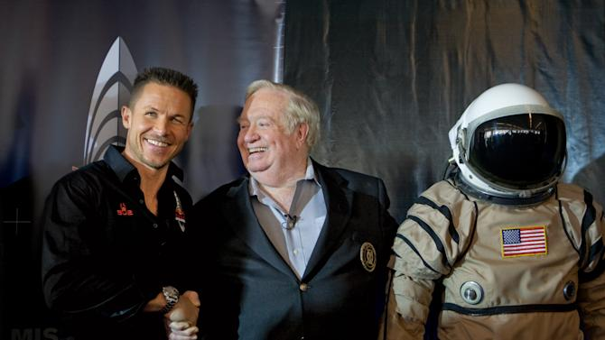 FILE - In this Friday Jan. 22, 2010 photo taken by AP Images for Red Bull Stratos, Felix Baumgartner, left, shakes hands with United States Air Force Col. (Ret.) Joe Kittinger, right, following the Red Bull Stratos press conference announcing Baumgartner's plan to attempt to become the first person ever to break the speed of sound with the human body in New York. Baumgartner is more than halfway toward his goal of setting a world record for the highest jump. A spokeswoman says the sky diver took a practice jump Thursday, March 15, 2012 from more than 13 miles high over New Mexico. He's aiming for nearly 23 miles in the summer. The record is held by Kittinger who jumped from 19.5 miles in 1960. (AP Photo/Red Bull Stratos, David Goldman)