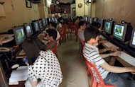 People visit an Internet shop in Hanoi. The United States on Wednesday called on Vietnam to free three bloggers facing trial for propaganda against the state, voicing deep concern at the self-immolation of the mother of one of the trio