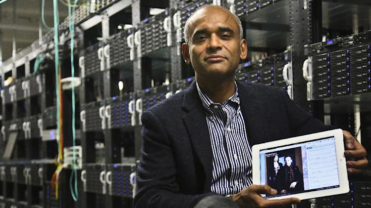 FILE - In this Thursday, Dec. 20, 2012, file photo, Chet Kanojia, founder and CEO of television-over-the-Internet service Aereo, Inc., shows a tablet displaying his company's technology, in New York. After the Supreme Court's ruling against the company, Aereo is now using the high court's own language to force broadcasters to treat it just like other cable TV companies. In Aereo's view, that means broadcasters must license its signals to Aereo under a 1976 copyright law. (AP Photo/Bebeto Matthews, File)