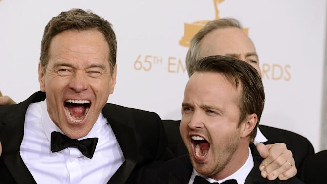 """Bryan Cranston, left, and Aaron Paul, winners of the best drama series award for """"Breaking Bad"""" pose backstage at the 65th Primetime Emmy Awards at Nokia Theatre on Sunday Sept. 22, 2013, in Los Angeles. (Photo by Dan Steinberg/Invision/AP)"""