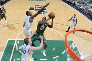 Favors leads Jazz past Warriors 99-92