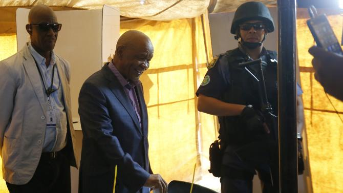 Lesotho's Prime Minister Thomas Thabane casts his vote during the national election in Magkhoakhoeng village